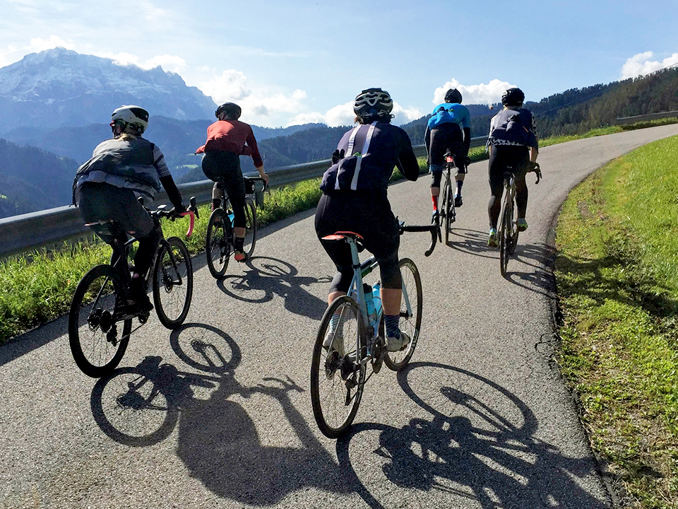 Cyclists riding in the Dolomites by Chris Case
